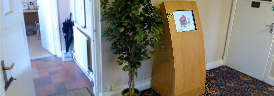 Image of the Apollo Curve touch screen kiosk at Enfield Crematorium